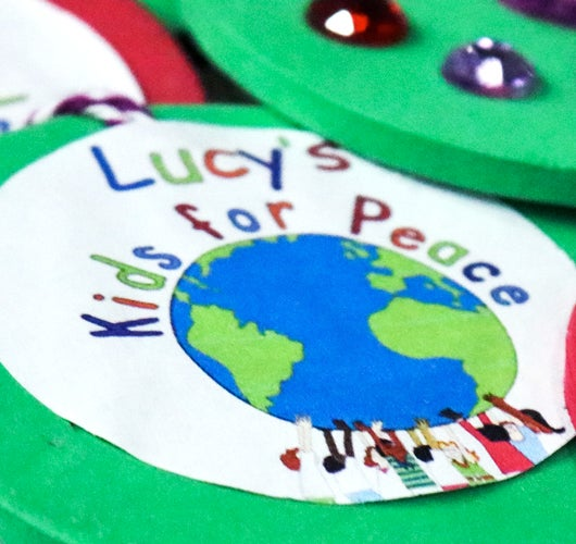 More Info for Lucy's Kids for Peace & Sprint Center Spread Holiday Cheer